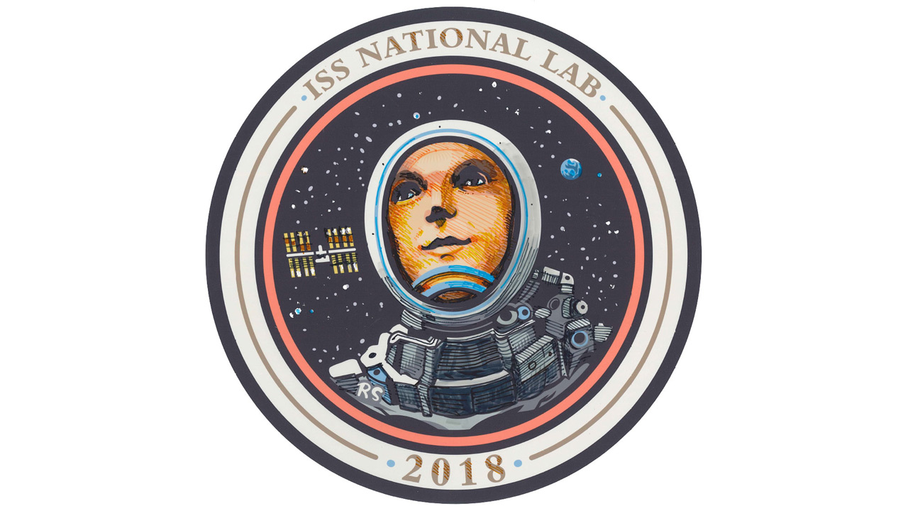 Ridley Scott Creates 2018 ISS US National Lab Mission Patch
